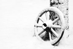 Winter. Old wooden wheel in the winter Royalty Free Stock Photography
