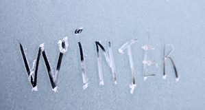 Winter. Written on a frosty window Royalty Free Stock Images