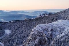 Winter. Sunrise in Massif Ceahlau, Romania Royalty Free Stock Photos