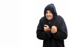 Winter. Man with cold, wearing a cotton jacket and a hood stock photography