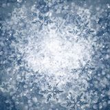 Winter abstract background with bokeh lights. Snowflakes Stock Images