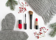 Winter accessories collage with cosmetics and clothes on white background. Flat lay, top view Stock Photography