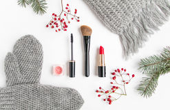Winter accessories collage with cosmetics and clothes on white background. Flat lay, top view Stock Image