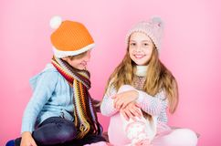 Winter accessories for kids. Girl and boy wear knitted winter hats. Winter season fashion accessories and clothes. Children playful mood christmas holidays stock photography