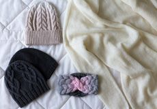 Winter accessory collection. Hat, scarf and mittens, on white background. Royalty Free Stock Images