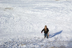 Winter activity. Boy with the sledge on suny winter day Royalty Free Stock Images