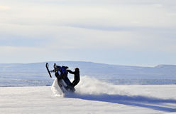 Winter adventure. Man alone on snowmobile n untouched nature in Finnmark, Norway stock photography