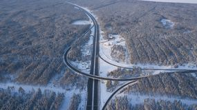 Winter aerial photo of transport junction, traffic cross road junction day. stock photo