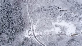 Snowy Mountain Forest. Winter Aerial Shot Of Snowy Mountain Forest  With Roads High Attitude Stock Photos