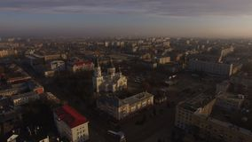 Aerial of suburbs at residential, historic and religious buildings. Winter aerial shot of the Zhytomyr city suburbs sunset residential, historic and religious stock video