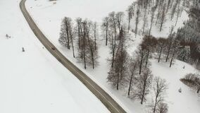 Aerial view of the mountain road. Winter aerial view above the mountain road stock footage