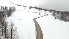 Aerial view of the mountain road. Winter aerial view above the mountain road stock video