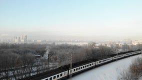 Winter aerial view of white passanger train pass on Railway.  stock video