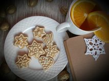Winter afternoon. Recipe of rest: a good book, a warm tea and delicious cake royalty free stock image
