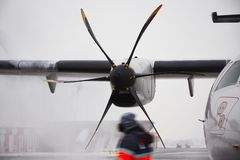 Winter at the airport. Winter time at the airport. Deicing of the airplane Royalty Free Stock Images