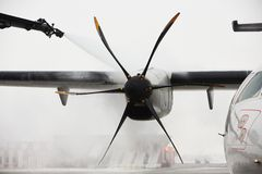 Winter at the airport. Winter time at the airport. Deicing of the airplane Royalty Free Stock Image