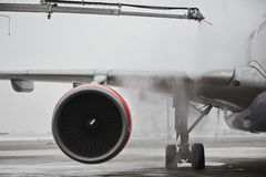 Winter at the airport. Winter time at the airport. Deicing of the airplane Stock Photo