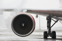 Winter at the airport. Winter time at the airport. Deicing of the airplane Royalty Free Stock Photography