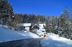 Winter in alp mountains austria village. View of beautiful winter forest, village, landscape in the austria Alps Royalty Free Stock Photo
