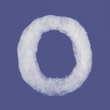 Winter alphabet, symbols made from cottonwool. Blue background isolated.All Letters. High resolution. Stock Photos
