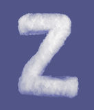 Winter alphabet, symbols made from cottonwool. Blue background isolated.All Letters. High resolution. Stock Images