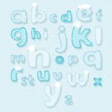 Winter alphabet under snow Royalty Free Stock Photo