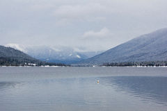 Winter Alpine Lake. Alpine lake and mountains photographed near Nelson BC, Canada Stock Photography