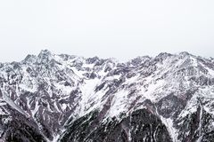 Winter Alpine landscape in a cloudy day. High mountains Royalty Free Stock Photography