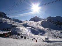 A winter alpine mountain scene under a blue sky. Winter alpine mountain scene under a blue sky Royalty Free Stock Photo