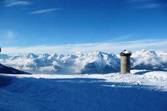 Winter alpine mountain scene under a blue sky Royalty Free Stock Photo