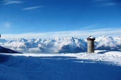Winter alpine mountain scene under a blue sky. Wintry alpine mountain scene under a blue sky Royalty Free Stock Photo