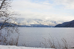 Winter Alpine Mountains. Alpine mountains photographed at kootenay lake near Nelson BC, Canada Royalty Free Stock Image