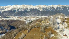 Winter alpine scenery. With small Romanian villages in the valley of Piatra Craiului mountains, Rucar Bran, Brasov county, Romania Royalty Free Stock Photos