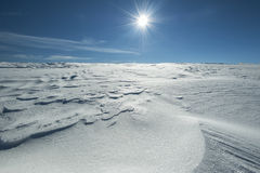 Winter alpine scenery with snow dunes and frozen snow Stock Photo