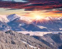 Winter alpine sunrise in mountains with dramatic sky Stock Photos
