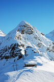 Winter Alps. Winter snowy Alps with cable railway cabin, Grindelwald in Bern Canton Switzerland Stock Photography
