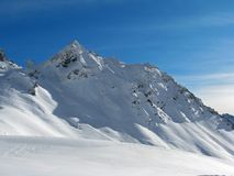 Winter Alps. Beautiful snow capped mountain in Austrian Alps stock images