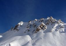 Winter Alps. Beautiful snow capped mountain in Austrian Alps Royalty Free Stock Photo