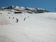 Winter in the Alps. Skiers on the mountain slopes Royalty Free Stock Photography