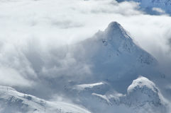 Winter in the Alps with clouds above the mountains Royalty Free Stock Photography