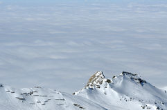 Winter in the Alps with clouds above the mountains Stock Image
