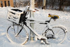 Winter in Amsterdam, Holland. A bike in the snow in Amsterdam during winter Royalty Free Stock Photography