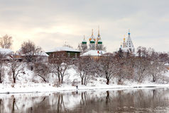 Winter in the ancient Russian city.  Churches  and ancient house Royalty Free Stock Photography