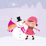 Winter And Christmas: Two Happy Children Making Sn Stock Photo