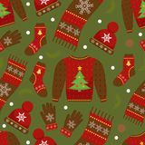 Winter apparel seamless pattern. Christmas clothes repeating texture. Warm clothing Infinite background. Sweater, gloves Royalty Free Stock Image