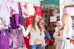 Winter apparel shop. Mother with baby visit the apparel shop with  winter wear Stock Images