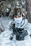 Winter arctic mountains sniper. Winter arctic mountains warfare. Action in cold conditions. Sniper with weapons in forest somewhere above the Arctic Circle Royalty Free Stock Image