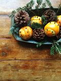 Winter arrangement with oranges, pinecones and evergreen royalty free stock photo