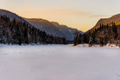 Winter arriving in Jacques Cartier Provincial Park, Quebec. Jacques Cartier Provincial Park covered in pristine snow at sunset Stock Photography