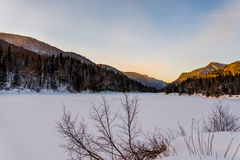Winter arriving in Jacques Cartier Provincial Park, Quebec. Jacques Cartier Provincial Park covered in pristine snow at sunset Stock Image